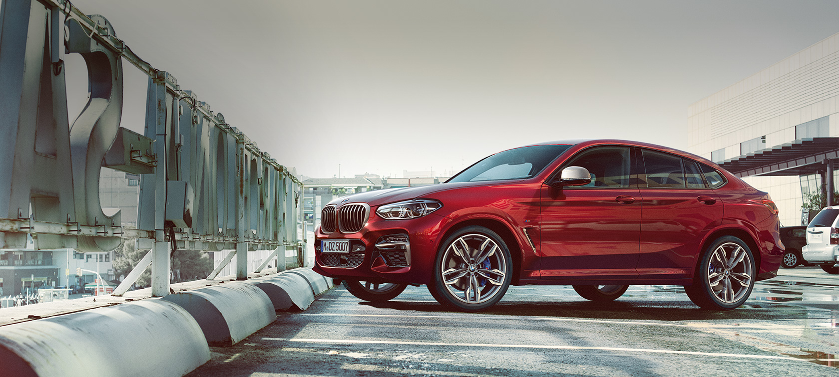 BMW X4 M40i G02 2018 Flamenco Red brilliant effect side view parking on parking deck